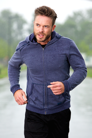 male athlete: Portrait of healthy attractive older male runner outside