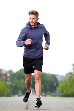 running man: Full length portrait of attractive older jogger training in street