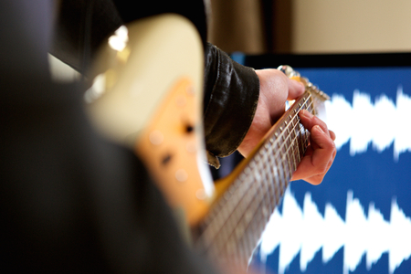 chord: Close up portrait of man playing chord on electric guitar