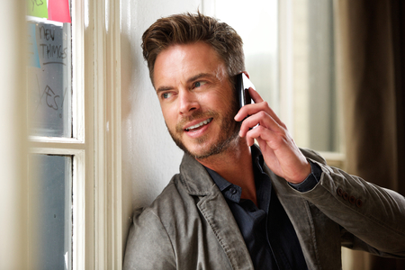 telephone call: Portrait of middle age professional man on telephone call