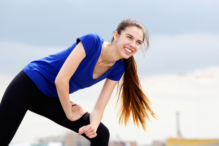 smile face: Portrait of sporty young woman enjoying workout routine Stock Photo