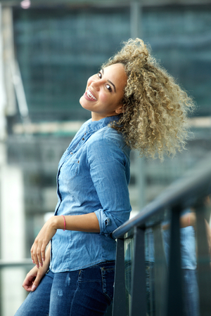 hair and beauty: Portrait of trendy young african american woman smiling