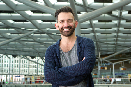 Close up portrait of happy mature man with beard standing outdoors and smiling 写真素材