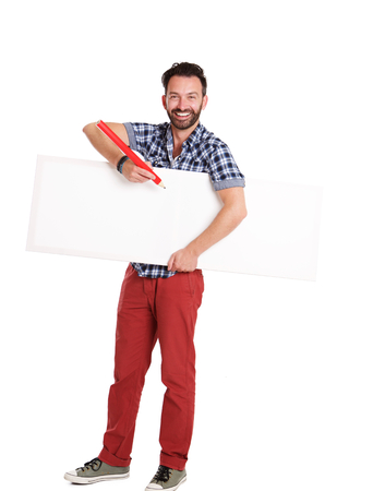 adult  body writing: Full length portrait of handsome mature man writing on blank poster over white background