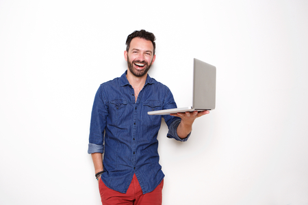Portrait of smiling mature guy holding laptop over white background