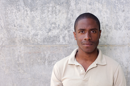 Close up portrait of young black man staring