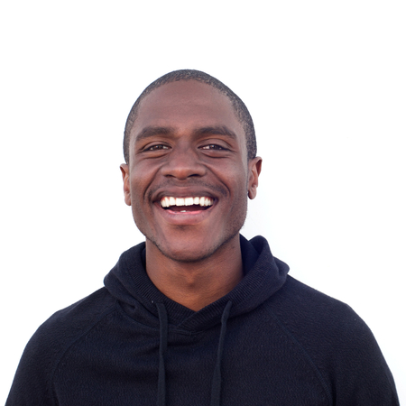 cool guy: Close up portrait of cool black guy laughing against isolated white background Stock Photo