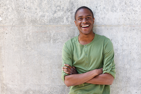 Portrait of smiling african American man with arms crossed Stock Photo