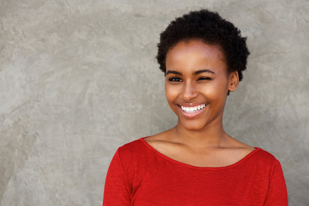 Portrait of beautiful young black woman winking eye and smiling Stock Photo