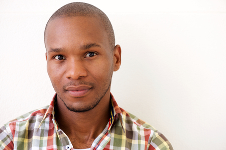 Close up portrait of young african american man against white background