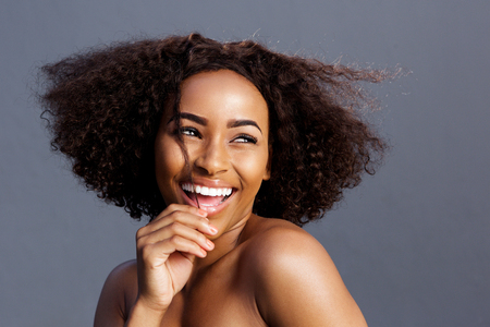 female model: Close up beauty portrait of young black female fashion model laughing Stock Photo