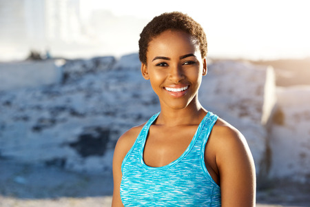 woman smiling: Close up portrait of young black sports woman smiling Stock Photo
