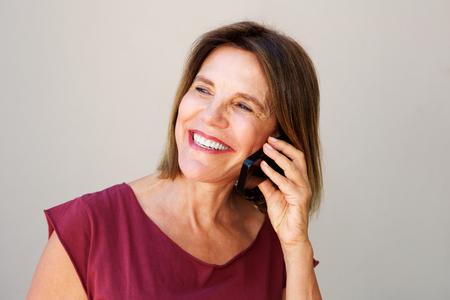 Close up portrait of older woman talking on mobile phone Imagens