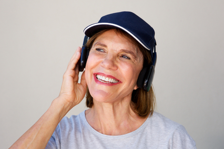 Portrait of happy woman listening to music on headphones Stock Photo
