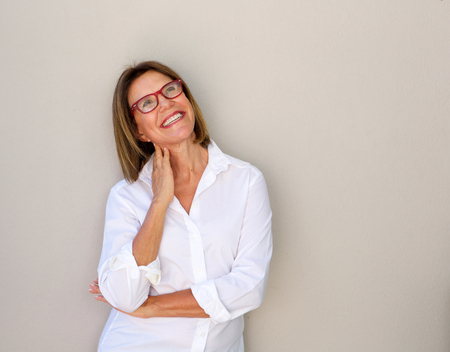 Portrait of smiling business woman with glasses looking up Stok Fotoğraf
