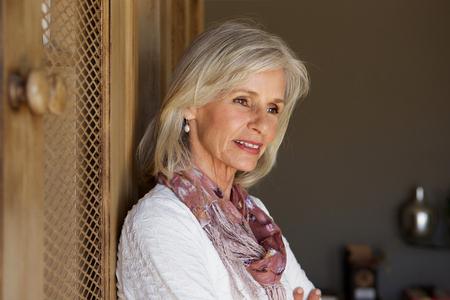 Close up portrait of beautiful older woman thinking Stock Photo