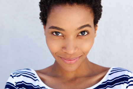 Close up portrait of afro american woman smirking Stock Photo