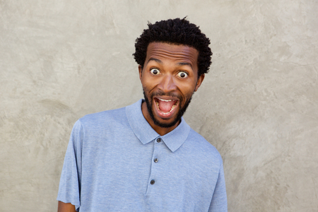 Close up portrait of black man with surprised expression on face Stock Photo