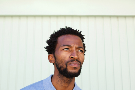 Close up portrait of serious african american man in contemplation