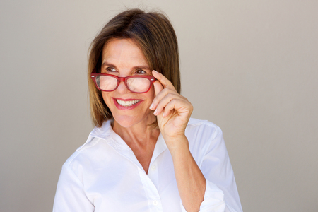 Close up portrait of businesswoman smiling and holding glasses
