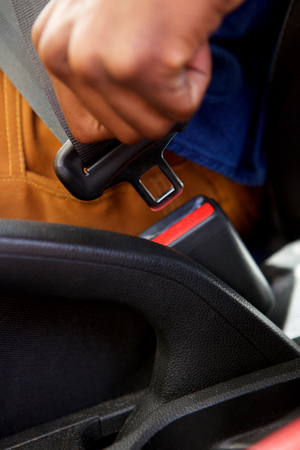 Close up portrait of man hand fastening a seat belt in the car Stock Photo