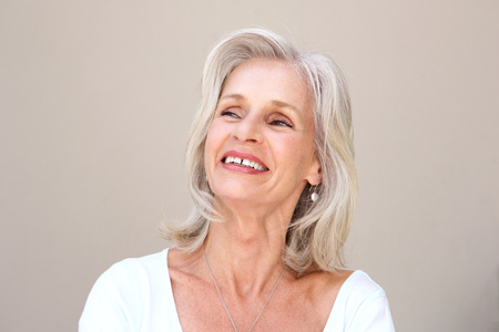 Close up portrait of happy senior woman smiling Stock Photo