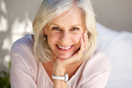 Close up portrait of mature woman smiling outside