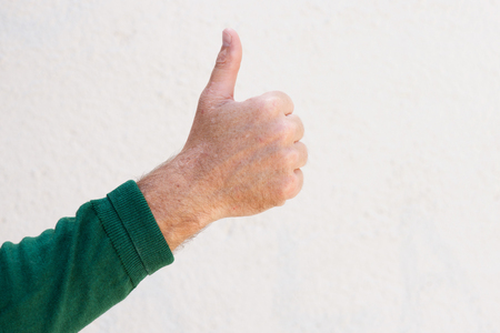 Close up portrait of male hand with thumbs up isolated on white background Stok Fotoğraf