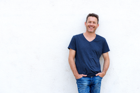 Portrait of happy casual man standing isolated on white background