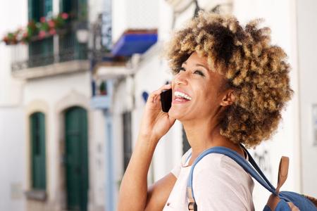 Close up portrait of cheerful young african american female talking on cellphone Lizenzfreie Bilder