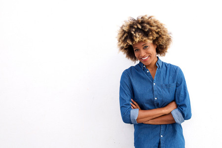 Portrait of happy african american female standing with arms crossed isolated on white background