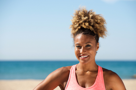 Close up portrait of sportswoman standing outdoor on a sunny day