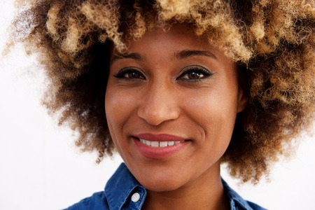 Close up portrait of beautiful young black woman isolated over white background