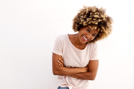 Portrait of cheerful african woman with arms crossed isolated on white background