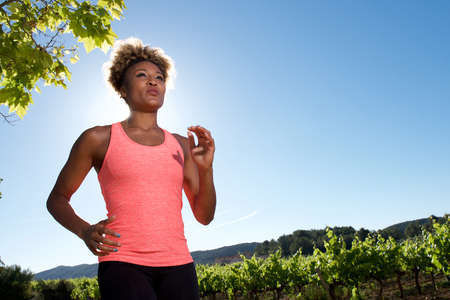 Portrait of healthy black woman jogging