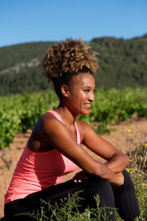 Side portrait of african american woman resting after workout Stock Photo