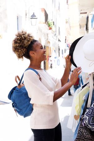 Portrait of young african woman shopping outdoors Lizenzfreie Bilder