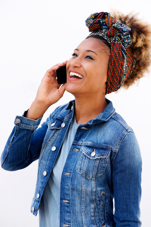 Portrait of beautiful african woman talking on mobile phone against white background Lizenzfreie Bilder