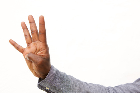 Close up portrait of male hand with four fingers count sign on white background