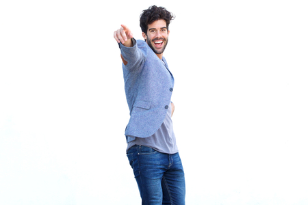 Portrait of happy man smiling and standing with arm outstretched pointing