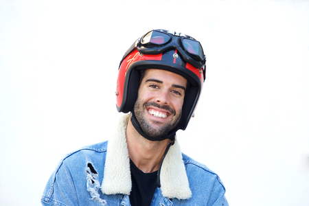 Close up portrait of smiling motorcyclist wearing helmet and jean jacket