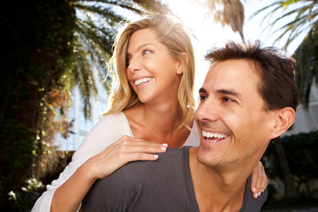 Close up portrait of smiling couple in love outside in embrace