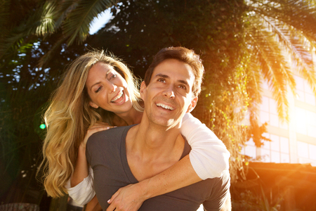 Close up portrait of laughing couple in love outside in embrace