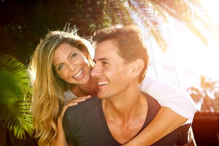 Close up portrait of happy couple in love outside in embrace Standard-Bild