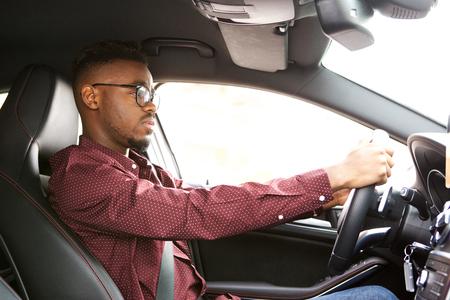 Portrait of african american man driving car Standard-Bild