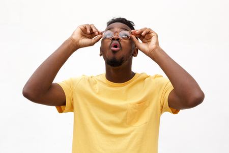 Portrait fo young black man with glasses looking up Standard-Bild