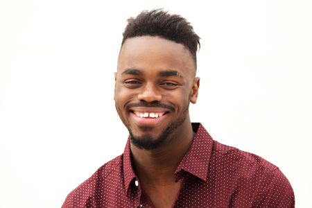 Close up portrait of happy young african man smiling against isolated white background