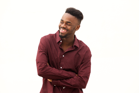 Portrait of happy young  african man laughing by white background