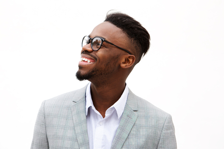 Close up portrait of happy young black businessman against isolated white background