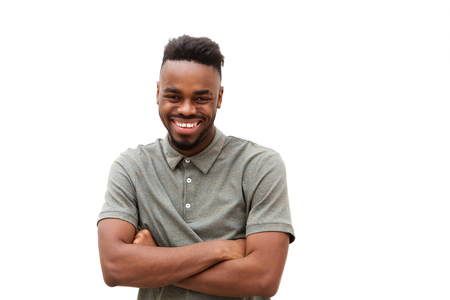 Portrait of happy young african american man smiling against isolated white background